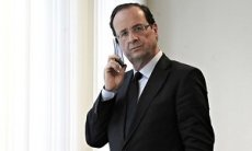 Francois Hollande on his phone